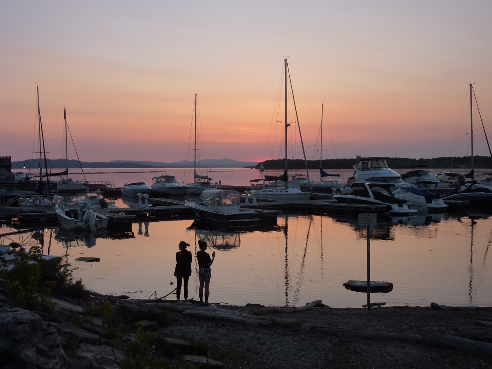 Sunset at the waterfront in Burlington, Vt., overlooking the Adirondack Mountains of New York .