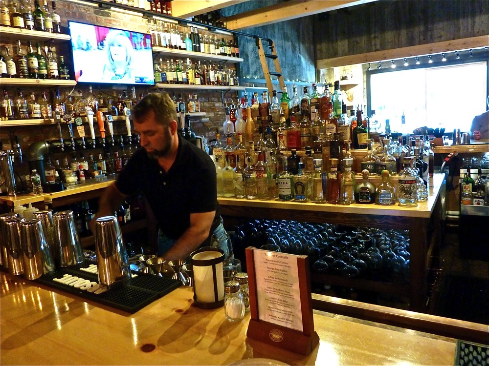 Benjamin Perry works the bar at The Charred Oak Tavern in Middleborough, Mass.
