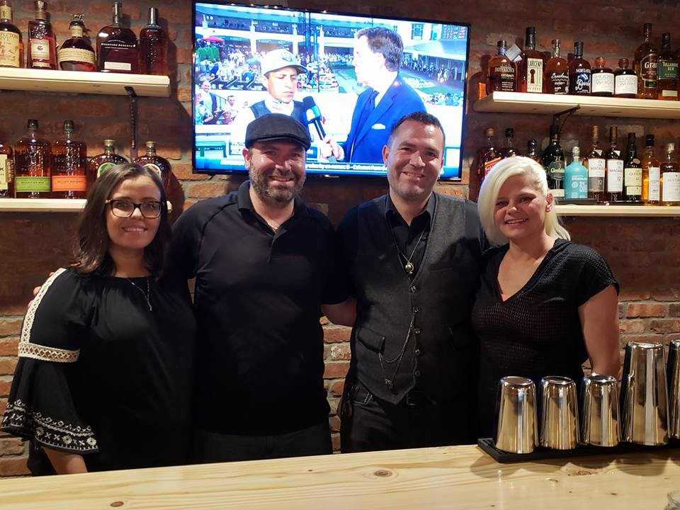 Matt and Michael Menard with wives Syliva (left) and Katrin (right) at Charred Oak Tavern in Middleboro, Mass.