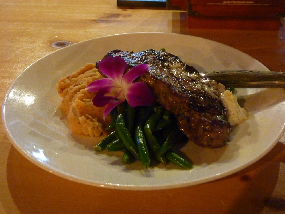 New York center cut sirloin steak with garlic butter, smoked BBQ whiskey mashed potatoes and green beans from The Charred Oak Tavern in Middleboro, Mass.