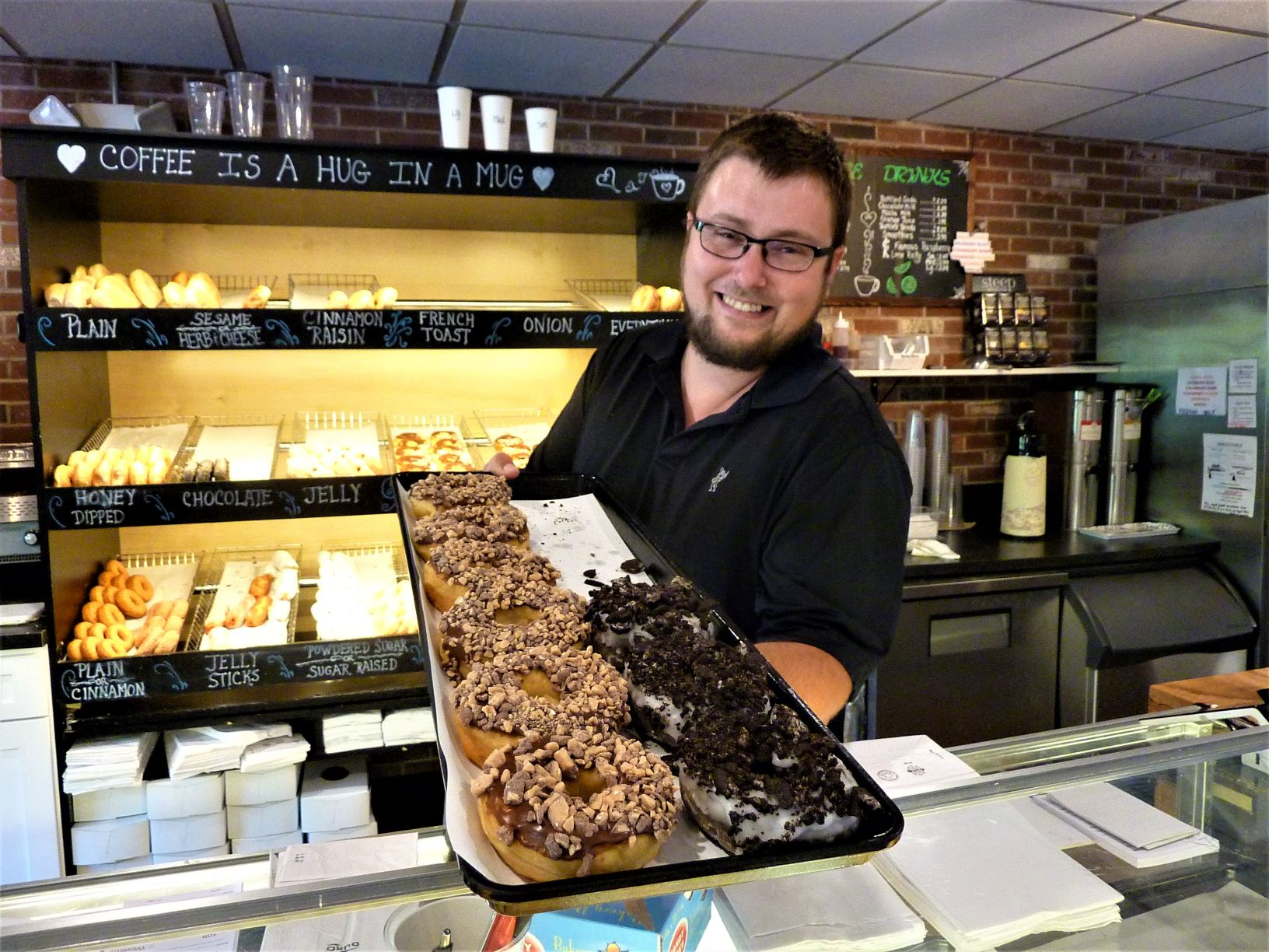 Trevor Stevens brings out fresh doughnuts from Country Kitchen Donuts in Millis, Mass.