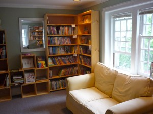 A cozy room with kids books and couch at Park Street Books (photo by Eric)