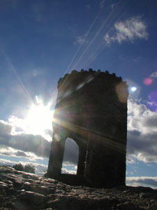 Picture of the stone lookout tower at the summit of Mt. Battie in Camden Hills State Park. Credit: Maine Office of Tourism.