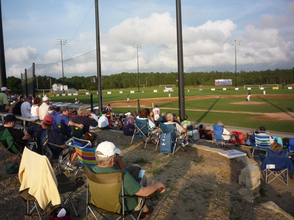 Fans watching the Bourne Braves play the Brewster Whitecaps in a Cape Cod League Baseball Game at Doran Field in Bourne, Mass.