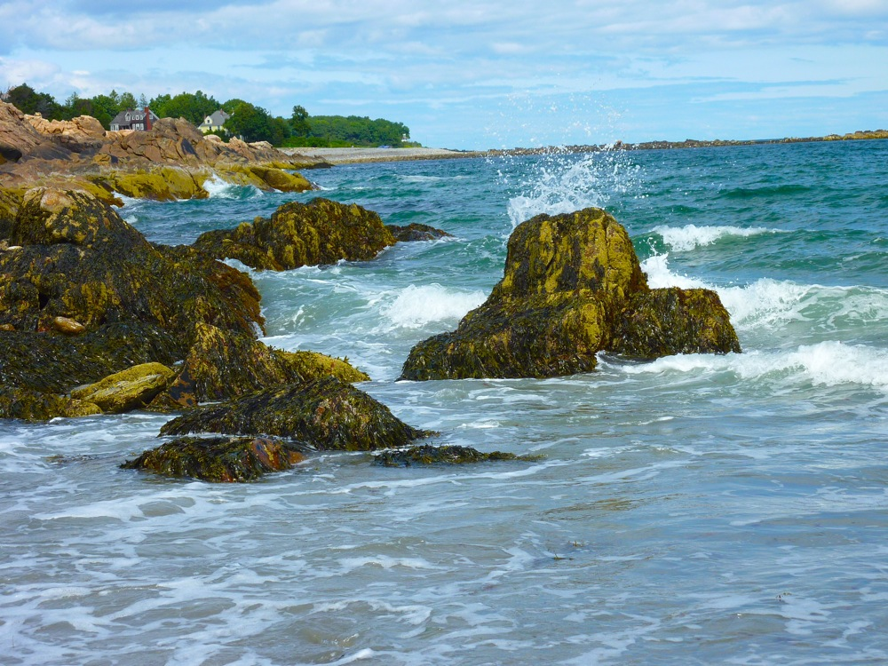 Water splashing on the rocks at Short Sands Beach, York Beach, Maine.