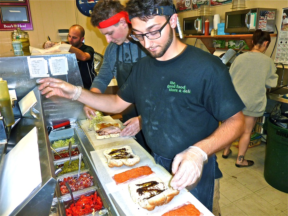 Adam Donaruma prepares a sandwich at the Good Food Store in Walpole MA.