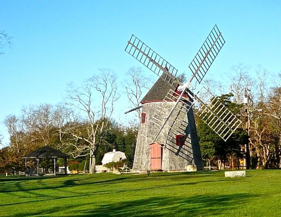 The town green with a windmill is...
