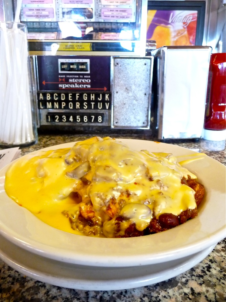 The Alamo at the Miss Florence Diner in Florence, Massachusetts, is a heaping mix of eggs, beef chili, corn muffin and cheese sauce.