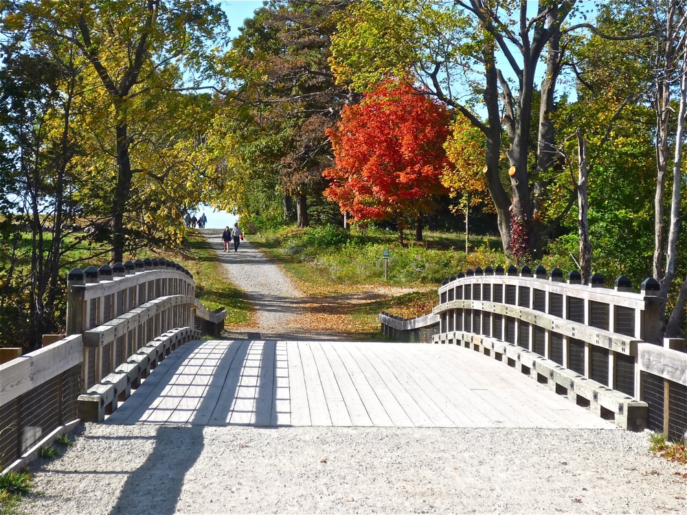 Walking bridge leads to carriage trail at World's End in Hingham, Massachusetts.