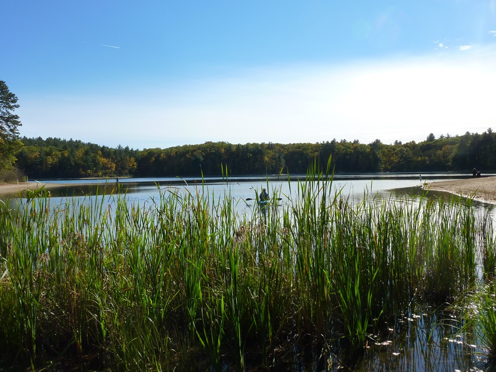 Placid waters, boater at Walden Pond in Concord, Massachusetts.