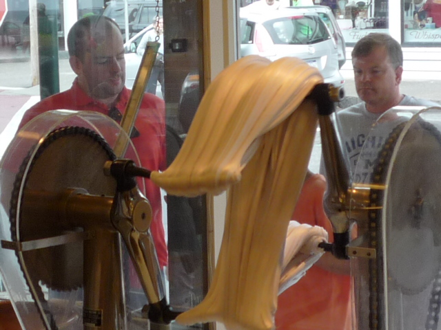 Watching the salt water taffy being made at The Goldenrod in York Beach,Maine.
