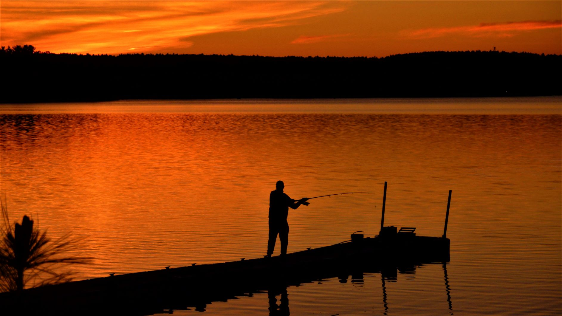 Mighty fine fishing and sunset while practicing social distancing at Lake Massapoag in Sharon, Massachusetts.